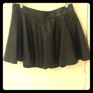 Dresses & Skirts - Black leather pleated miniskirt